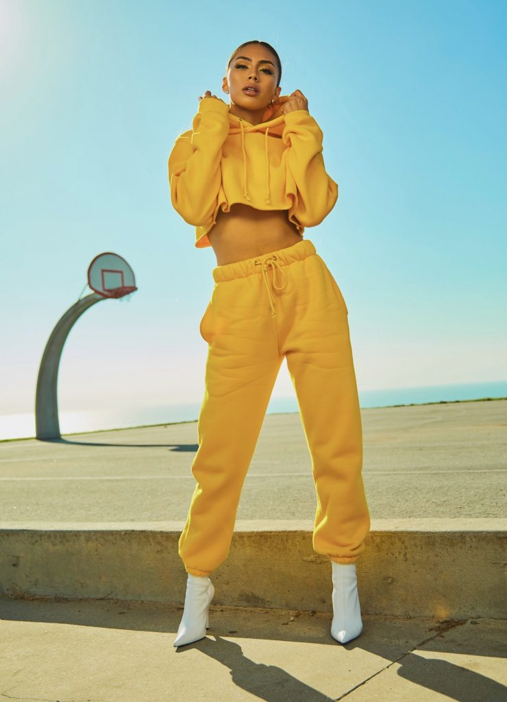 All-Yellow Outfit and White Pointed Heels