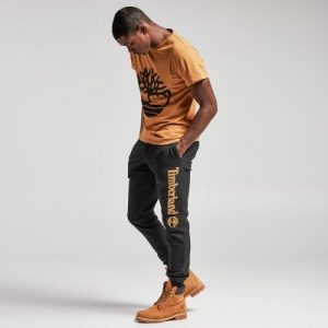 Apricot Tee With Black Sweatpants and Khaki Work Boots