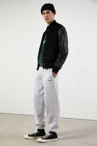 Black Leather Jacket, Sneakers, and Socks with Gray Sweatpants