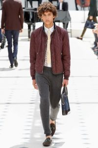 Maroon Leather Jacket Paired with Gray Sweatpants and Brown Loafers