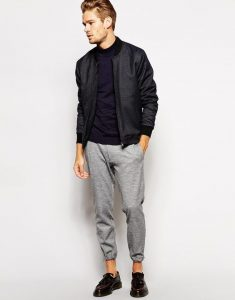 Men's Charcoal Bomber Jacket Paired with Gray Sweatpants and Burgundy Leather Tassel Loafers