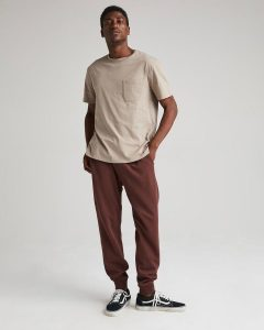 Wine Red Sweatpants with Neutral Shirt and Black Sneakers